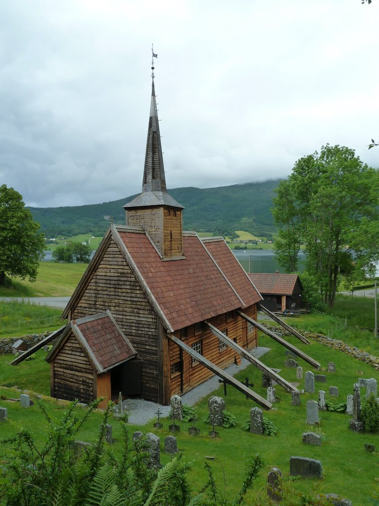 Rødven stave church in Rauma, Møre og Romsdal, Norway. Estimated built around 1300, but contains older elements. | Photo: Karin Axelsen - kulturminnebilder.ra.no T328_01_0400 - CC BY.