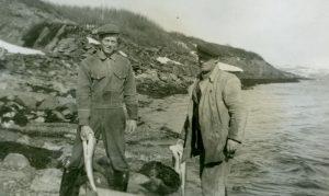 Men fishing on the coast of Finnmark, Norway. | Photo: Finnmark Fylkesbibliotek - digitaltmuseum.no FBib.13004-036 - public domain.
