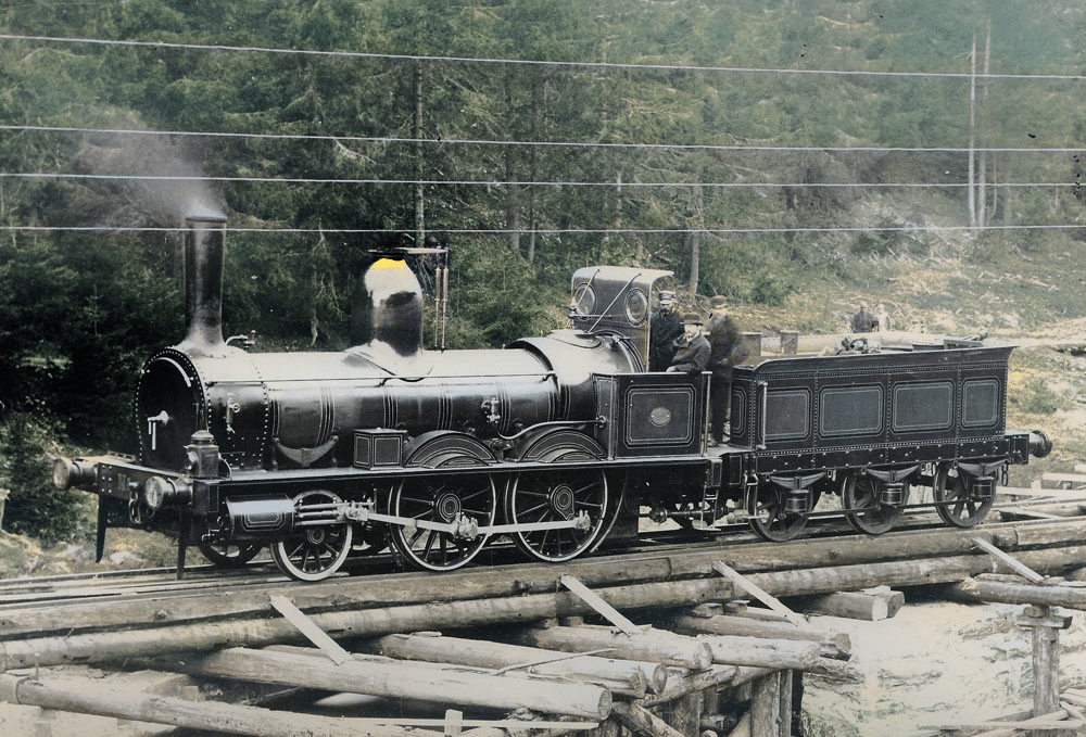 One of the early locomotives on the Oslo-Eidsvoll line - around 1860. Made by the Robert Stephenson company in Newcastle. | Photo: Wikimedia DeOldify cc pdm.